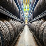 The Benefits of Seasonal Tire Storage-racks of tires stored in a warehouse